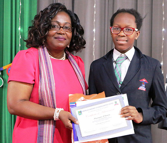 Director AUN Writing Center, Ms. Emilienne Akpan, Presenting the Second Place Award for the Academy's Writing Competition to Precious Olowu