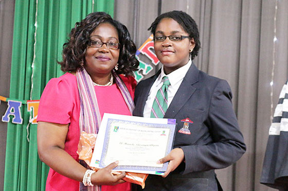 Director AUN Writing Center, Ms. Emilienne Akpan, Presenting the First Place Award for the Academy's Writing Competition to El-Miracle Idorenyin Akpan
